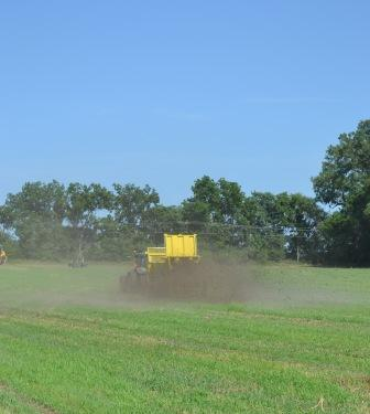 Spreading manure solids on field