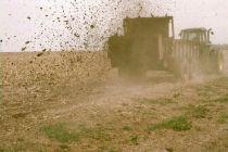 a truck kicking up dirt