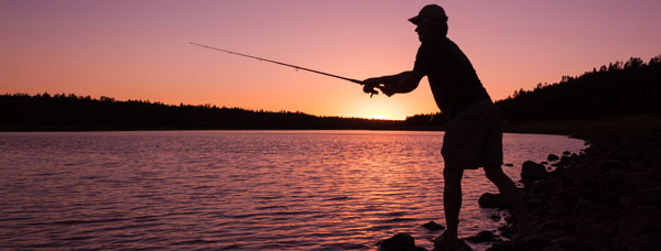 Man fishing at sunset